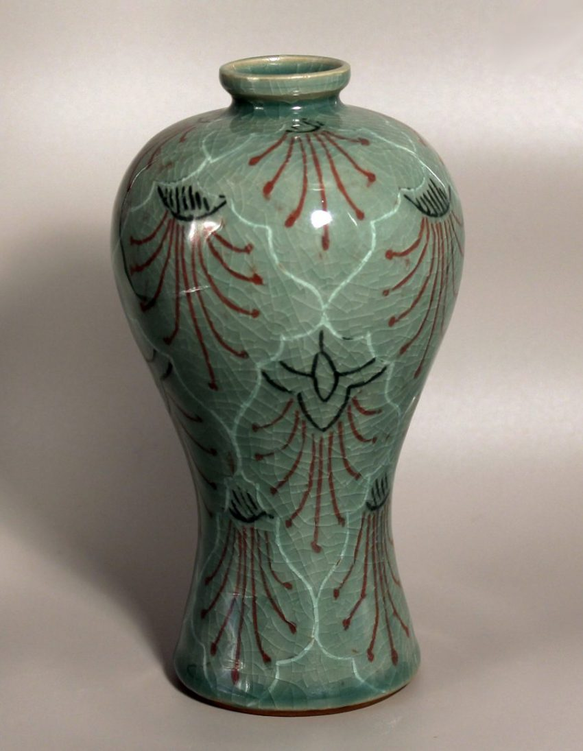 Korean style vase decorated with incised slip techniques in red, black and white and glazed in a green celadon glaze - Bates