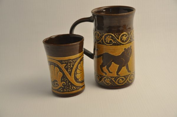 Mug and tumbler - red clay with white slip, carved in the style of grecian urns with acanthus vines and a large cat