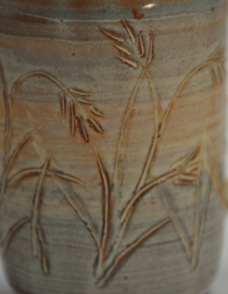 Sgraffito detail photo of mug