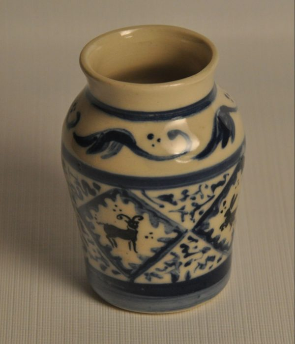 Small Medieval apothocary jar - painted in Andalusian style in blue and black, with 4 blocks with animal silhouettes, this face showing a horned deer like animal