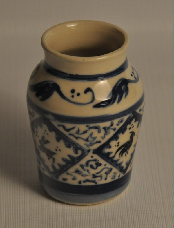 Small Medieval apothocary jar - painted in Andalusian style in blue and black, with 4 blocks with animal silhouettes, this face showing a bunny and a bird