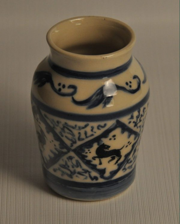 Small Medieval apothocary jar - painted in Andalusian style in blue and black, with 4 blocks with animal silhouettes, this face showing a dog