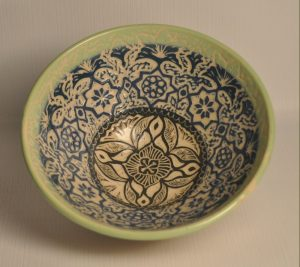 Tall footed bowl - interior slipped in blues, black and green and carved through