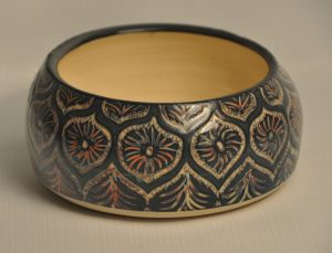 Shallow bowl - outside sgraffito through 5 different colours of slip with black on top
