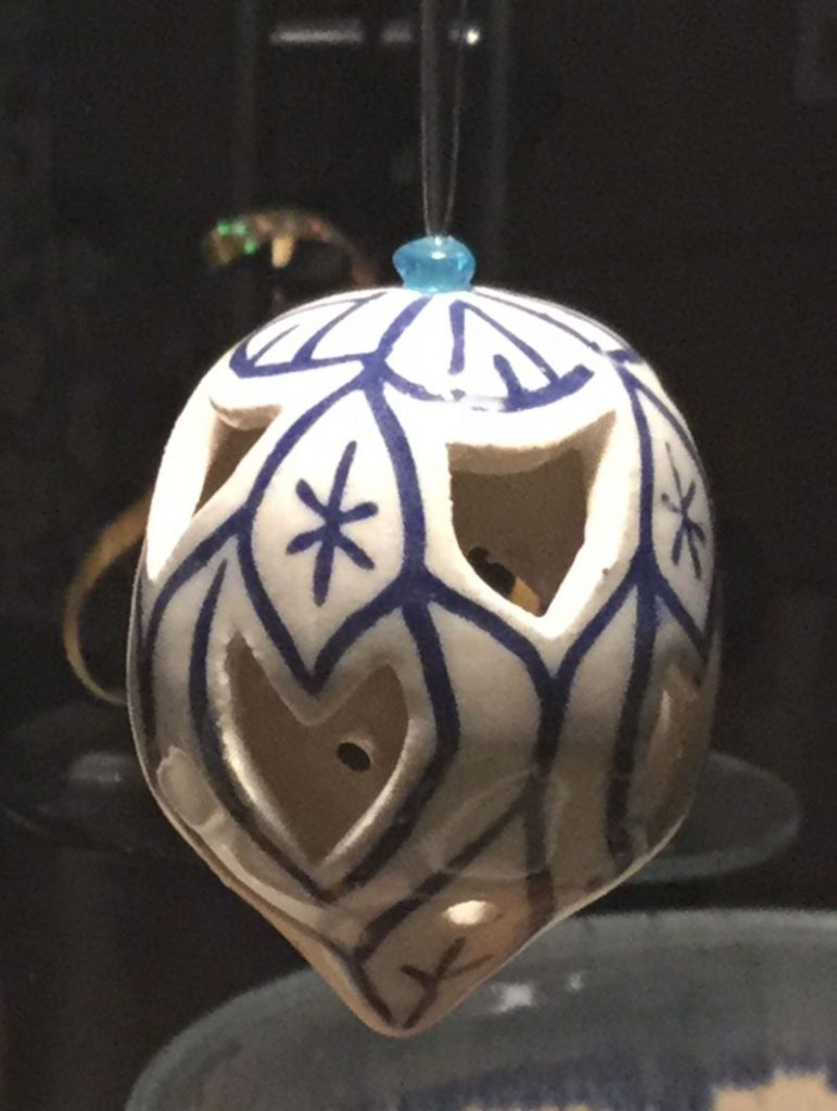 Xmas decoration - closed form in white clay with blue incised lines and cut work