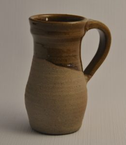 Replica of early northern era jug remade as modern mug size, amber brown glaze inside and partially outside