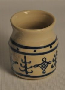 Cobalt blue lines painted on white clay, small medieval apothecary style jar