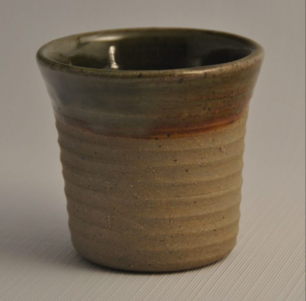 straight sided tumbler with finger marks, glazed inside with green, only partially glazed exterior