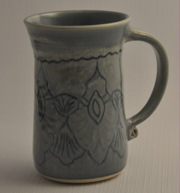 Mug carved with lines in Persian design, filled with coloured slip, glazed in semi-transparent blue-grey glaze