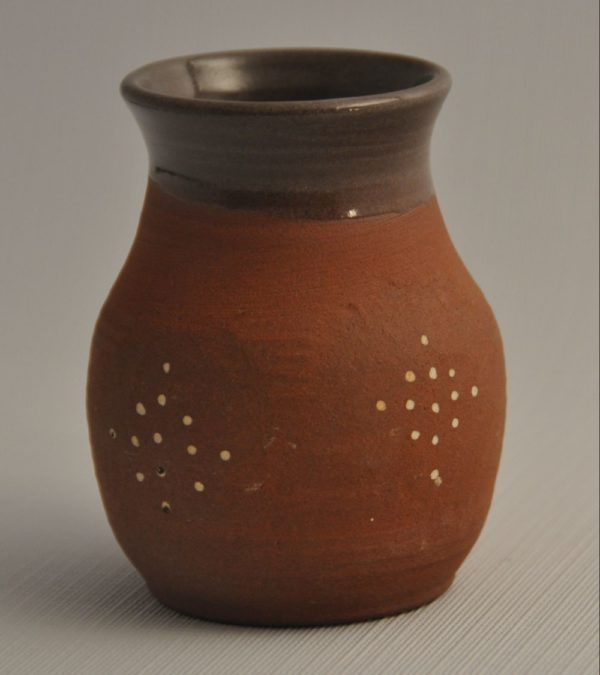 Red clay tumbler decorated with white slip dots, glazed clear in interior and just over lip