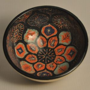 Small bowl - interior painted in 5 layers of different coloured slip and carved through, black on top