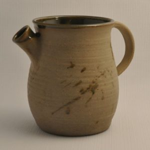 Norse era pitcher glazed inside with green and splashed exterior glaze with a short spout