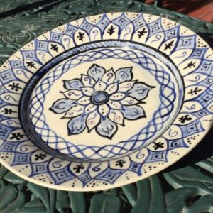 Large platter painted in blue and black with touches of red in Andalusian tile style