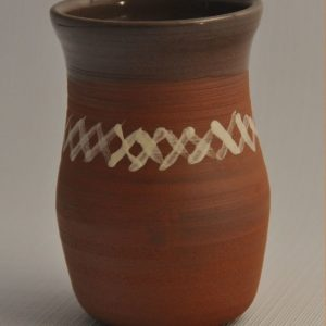 Tumbler in red clay with white X markings glazed in clear inside and over lip
